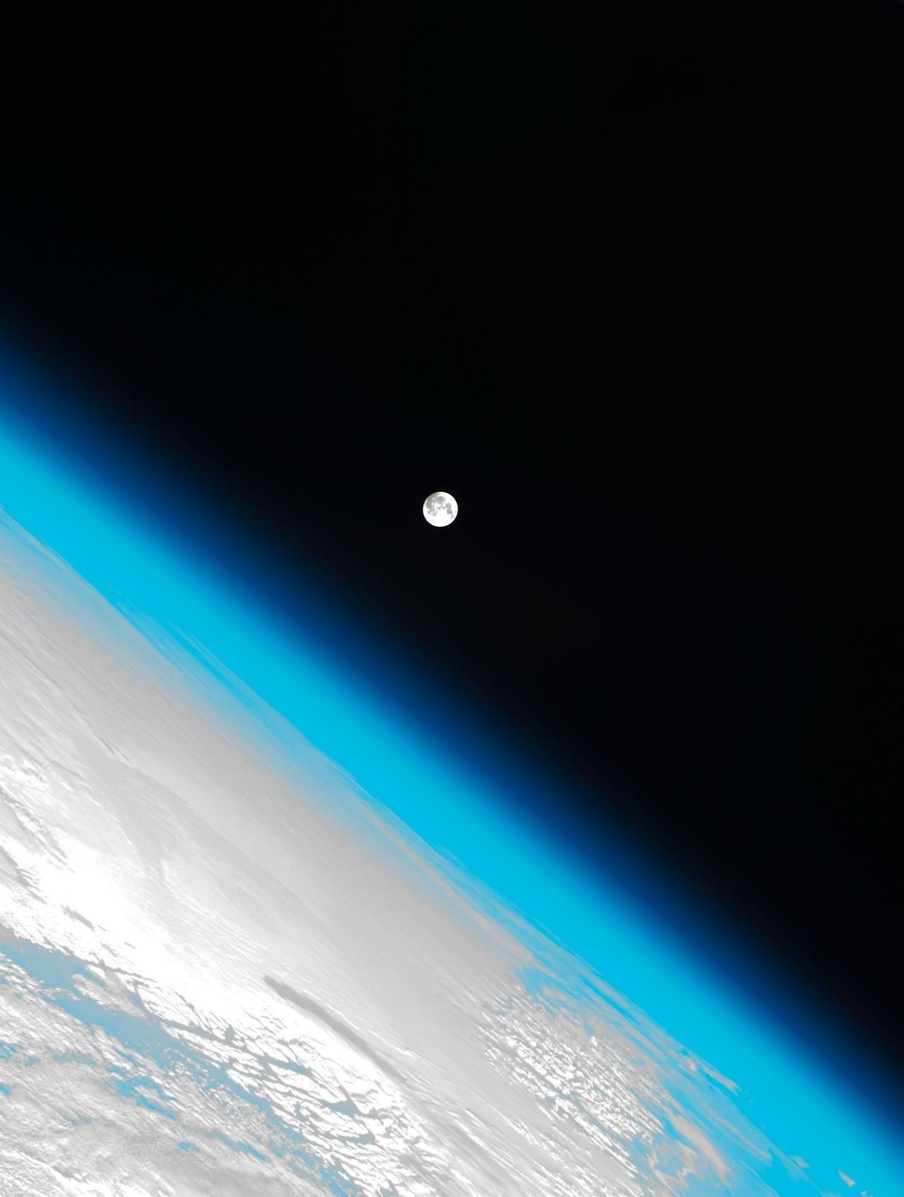 Photo Of The Earth S Atmosphere And The Moon Shot By The
