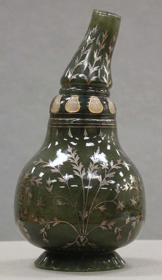 Bottle in the Shape of a Gourd. Jade (nephrite) inlaid with gold and stone. Mughal, India.