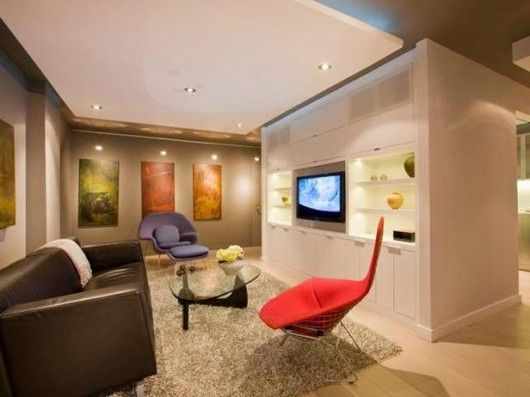 Accent And Ambient Lighting A Dropped Ceiling With Recessed Light Fixtures Provides General Illumination For This Contemporary Living Living Room Lighting Design Contemporary Family Rooms Living Room Lighting