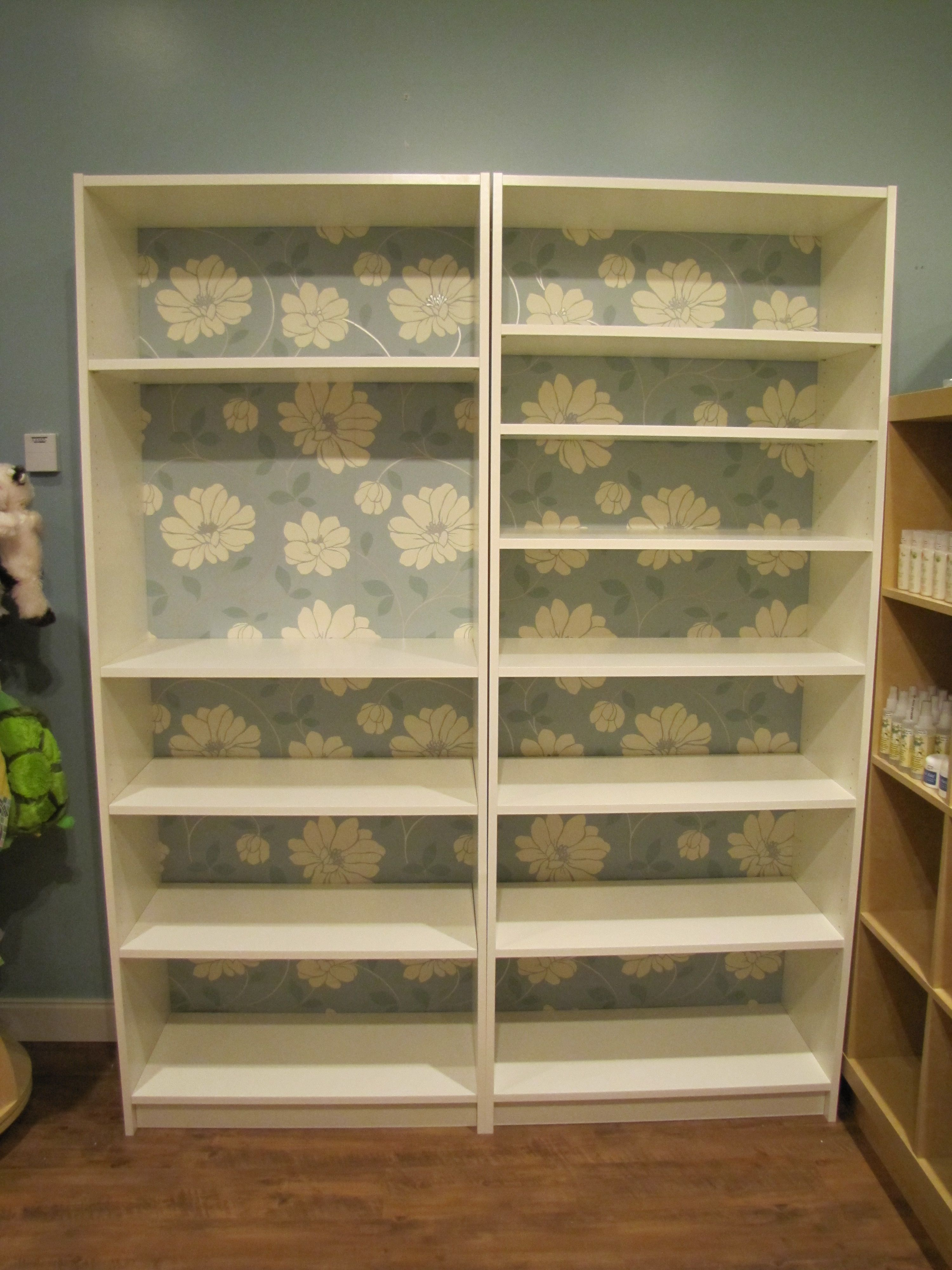 Ikea Hack... I added wallpaper to the back of 2 Billy Bookshelves.  Love it!  Gives it character & personality!