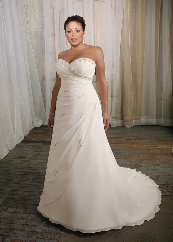 abito da sposa con corpetto a cuore e decorazioni di perle e ...