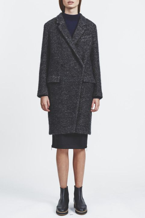 House of Dagmar Anissa coat is a classic coat with relaxed fit. The coat is fully lined and features hidden button closure and a back center seem. Two flap front pockets and a slight diagonal cut.