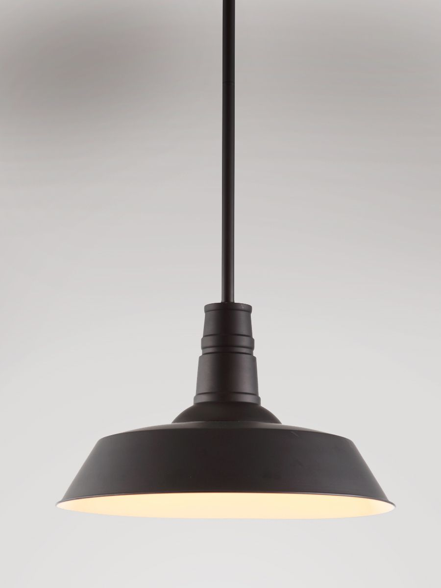 this classic school house pendant takes an edgy modern turn in matte black.  the white interior brings levity to any room, and shines a bright light on style, sufficient to add interest above a kitchen island, breakfast table or above any sink in the home.