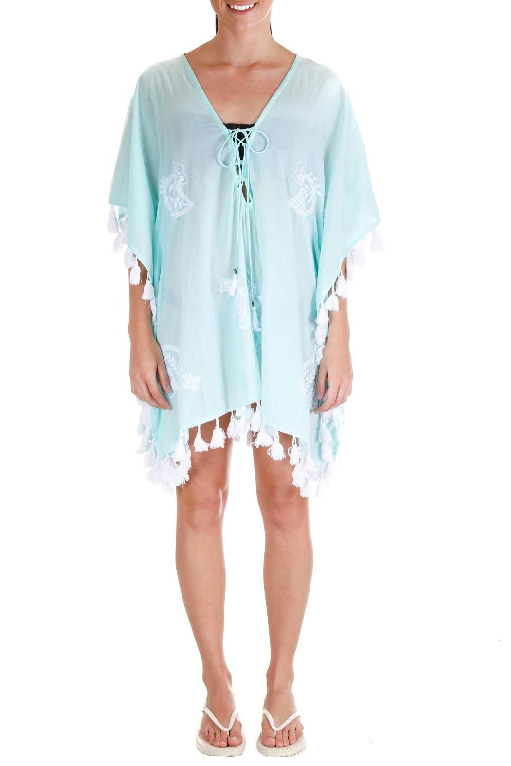 Boho beach. Effortless is stylish an the Z&L White Sands CoverUp proves that true. Over anything, this tunic style cover is a gorgeous universally flattering hue finished with bright white tassels to give a bohemian flare to an otherwise classic shape and style. From pool to sand this piece offers stylish luxury with an easy feel and wear ability.   White Sands Coverup by Z&L Europe. Clothing - Swimwear - Cover Ups New York
