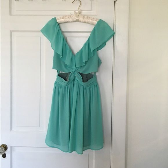 Teal cutout dress This lightweight dress is a perfect mix of sweet and sexy blow neck line with ruffle detail. Cutouts at waist. Playful skirt. Keepsake from nordstrom Dresses