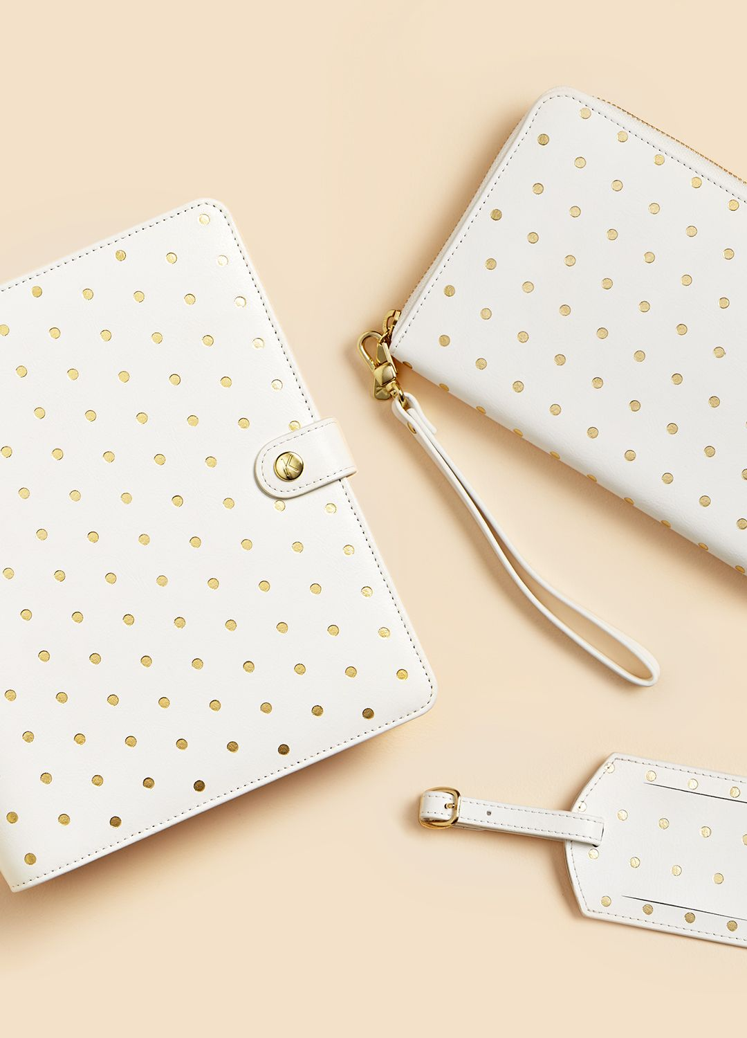 Fall in love with polkadots with this gorgeous brushed gold leather collection featuring our favourite Travel Wallet, kikki.K Planner and Luggage Tag.