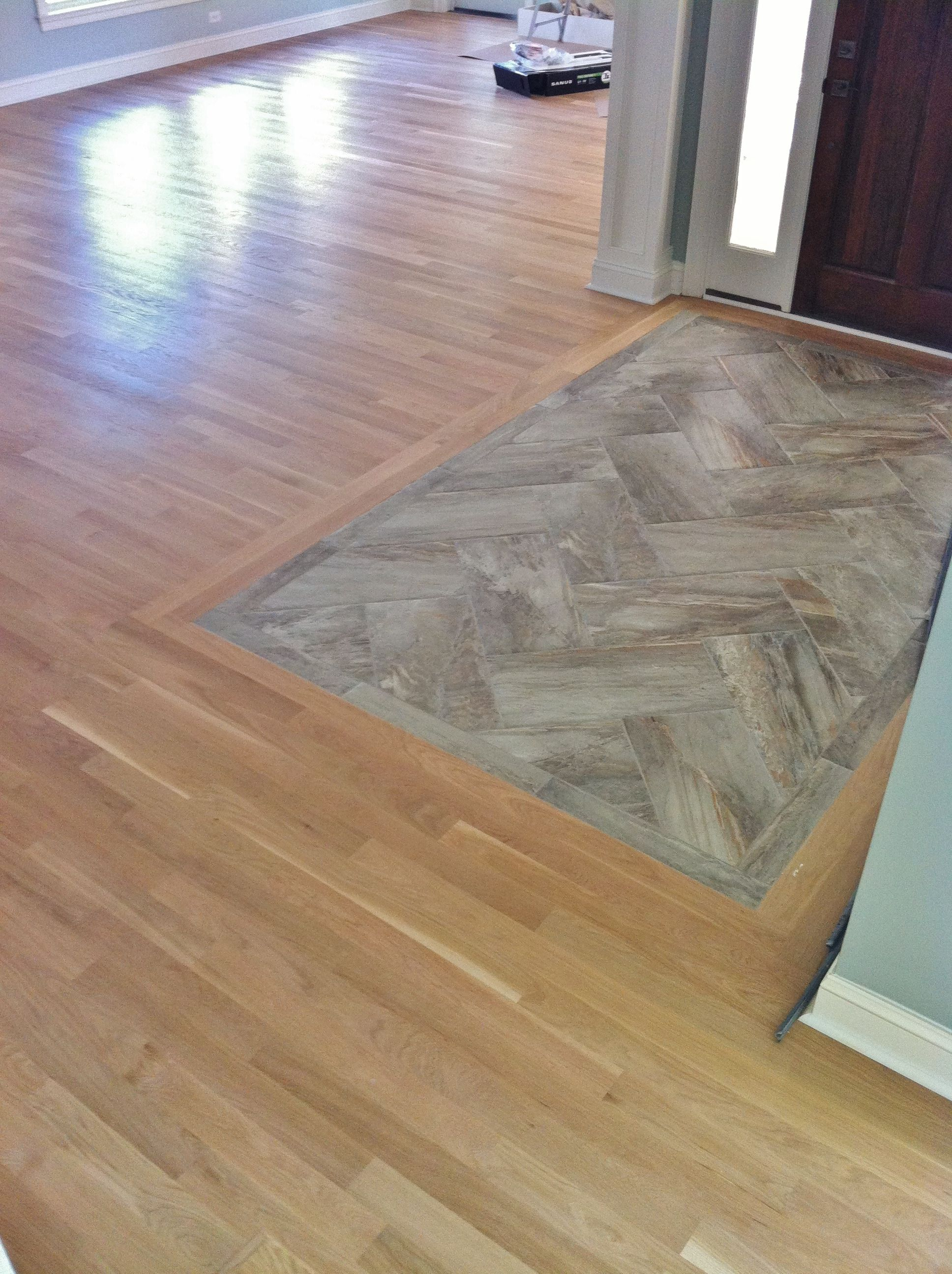 12x24 earthen essence porcelain tile insert at entryway tile is tile is set in the herringbone pattern with a border of tile and then 2 pieces of white oak picture frame the tile dailygadgetfo Gallery