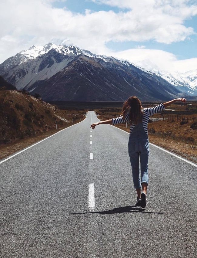 girl in overalls on the road