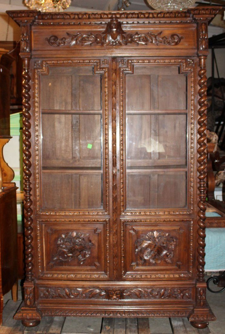 French Louis XIII Bookcase in Carved Oak newveauctioneers
