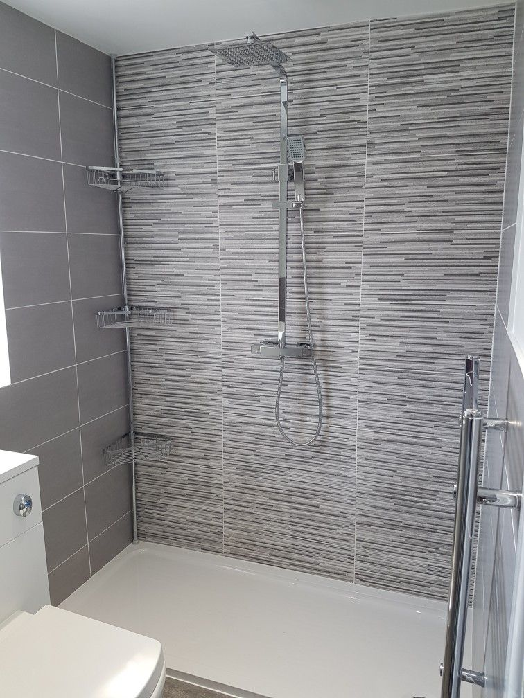 Grey Porcelain Wall Tile With Feature Wall Using Split Face Tile Built In Bathroom Storage Tile Bathroom Bathroom Cabinets Designs