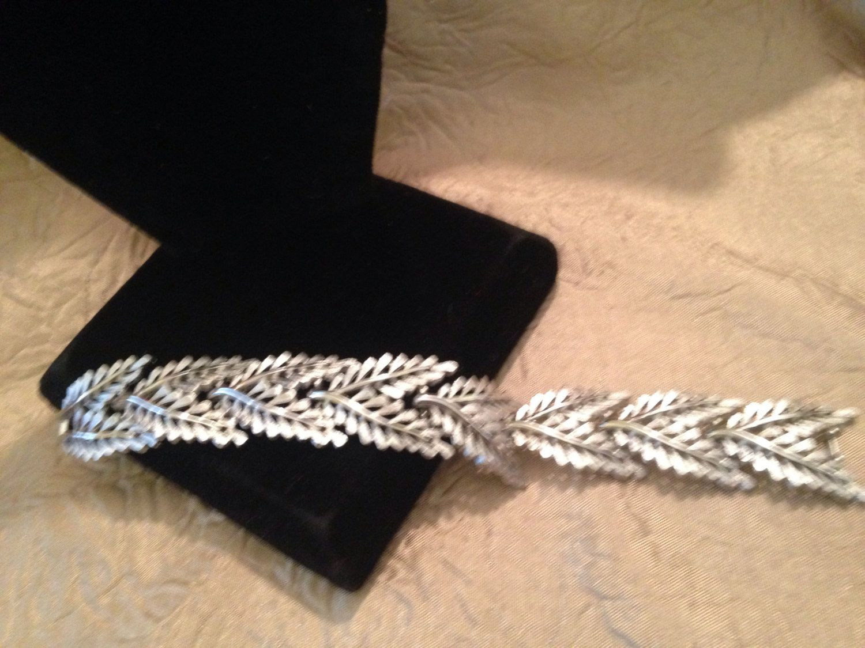 A personal favorite from my Etsy shop https://www.etsy.com/listing/480910904/crown-trifari-silver-leaf-link-bracelet