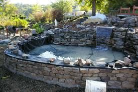 Building a raised pond a block or brick structure once the for Concrete koi pond construction