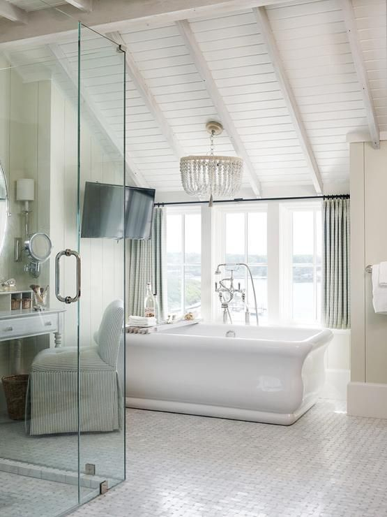 Chic Bathroom Boasts A Vaulted Shiplap Ceiling Lined With