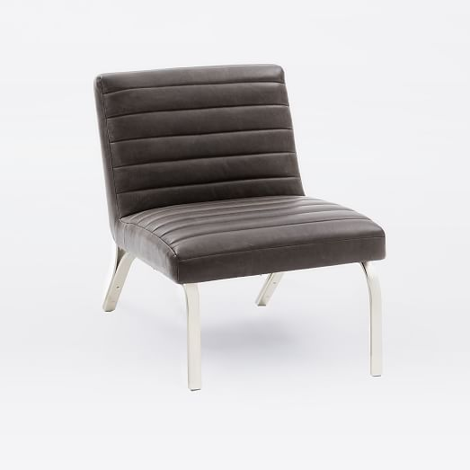 A New Spin On An Iconic Form Our Emil Slipper Chair Features Fluid Metal Frame That Hugs Channeled Leather Seat Its Brushed Nickel Finished And