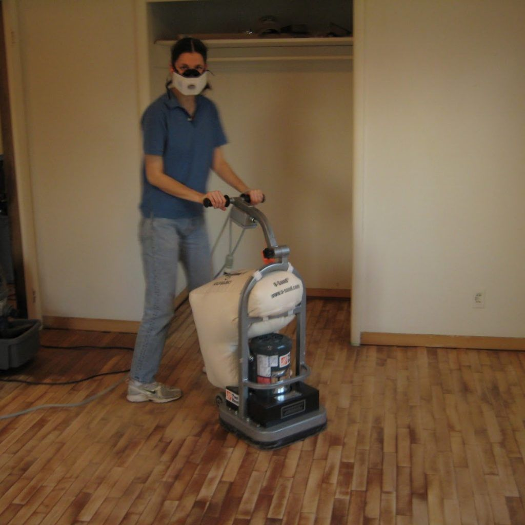 Sanding A Hardwood Floor With Orbital Sander Refinishing