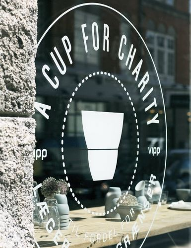 A Cup For Charity pop-up café supporting Doctors Without Borders in Vipp Flagship Store in Copenhagen. Coffee + cake = 100 DKK. All proceeds go to charity - and as thanks you get to keep the Vipp cup.