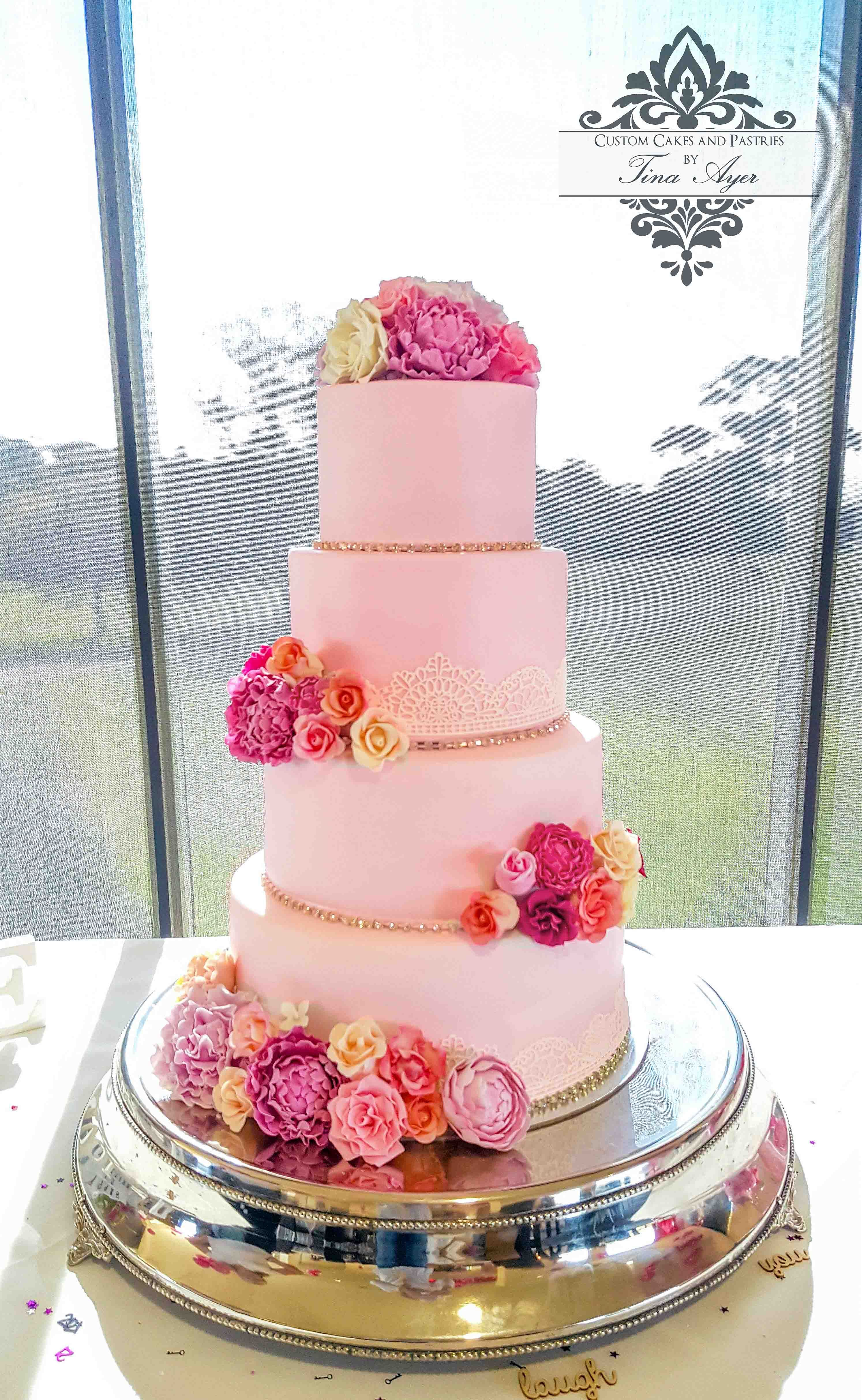 Pink and white lace wedding cake with sugar flowers created by ...