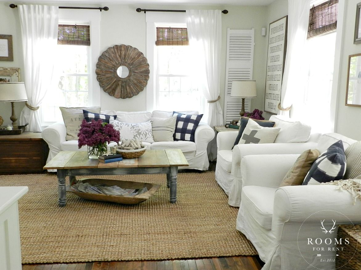 Love this neutral living room - it's so cozy with the white slipcovered furniture eclecticallyvintage.com