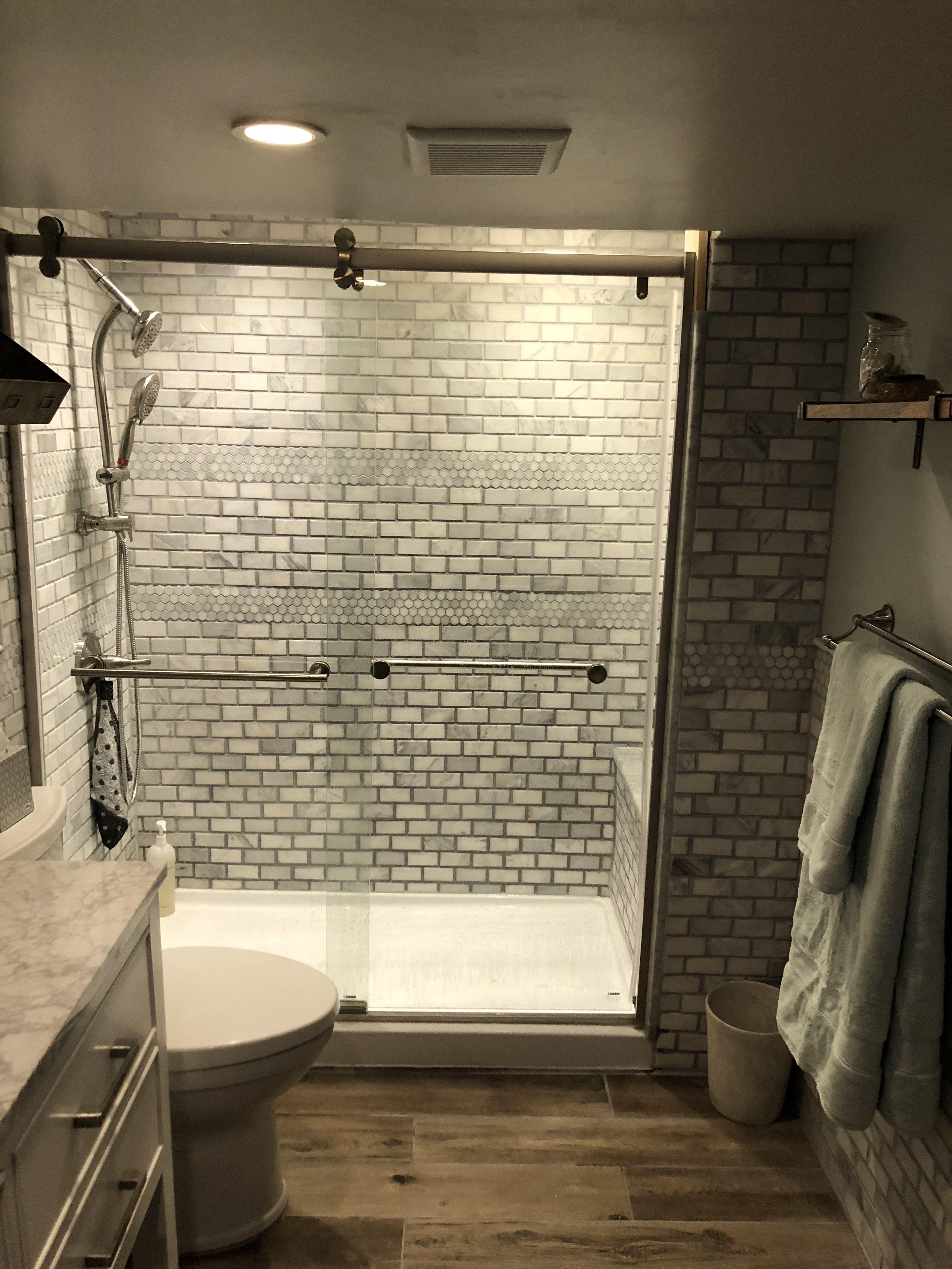 Basement bathroom marble shower with marble seat sea salt sw paint