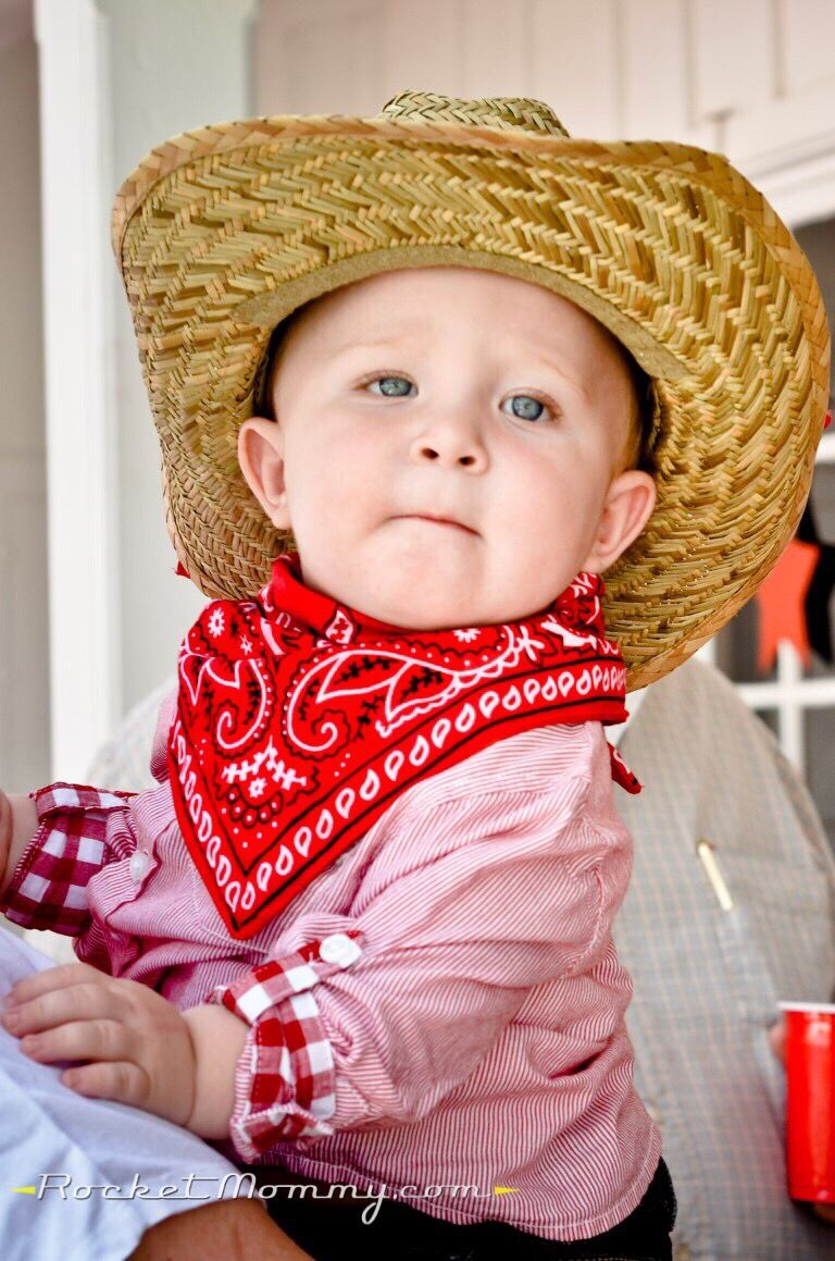 Little birthday boy at his cowboy themed birthday party - www.rocketmommy.com