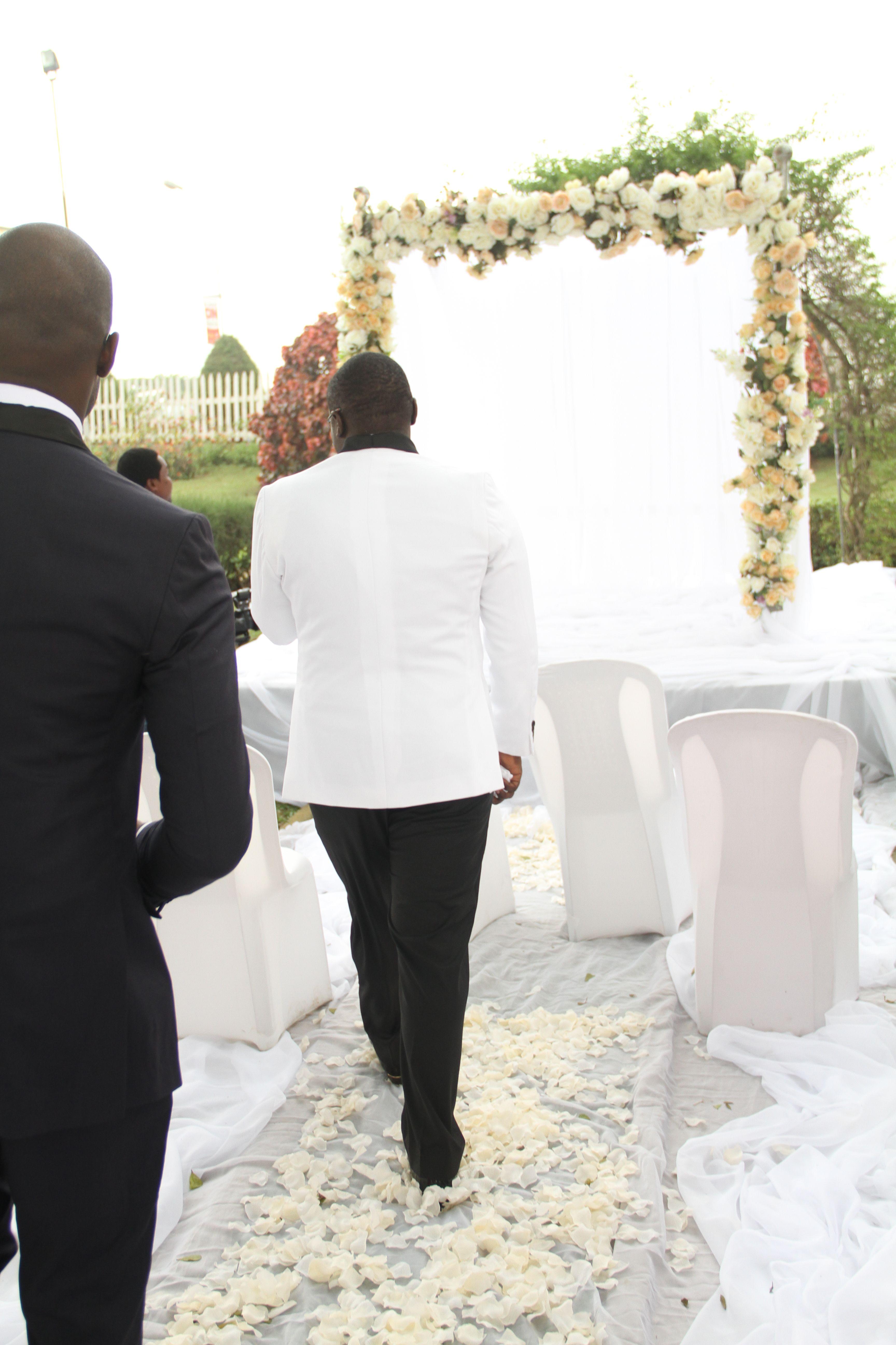 JHALOBIA GARDEN WEDDING VENUE IN LAGOS NIGERIA : FLOWER ARCH FOR EXCHANGE OF VOWS