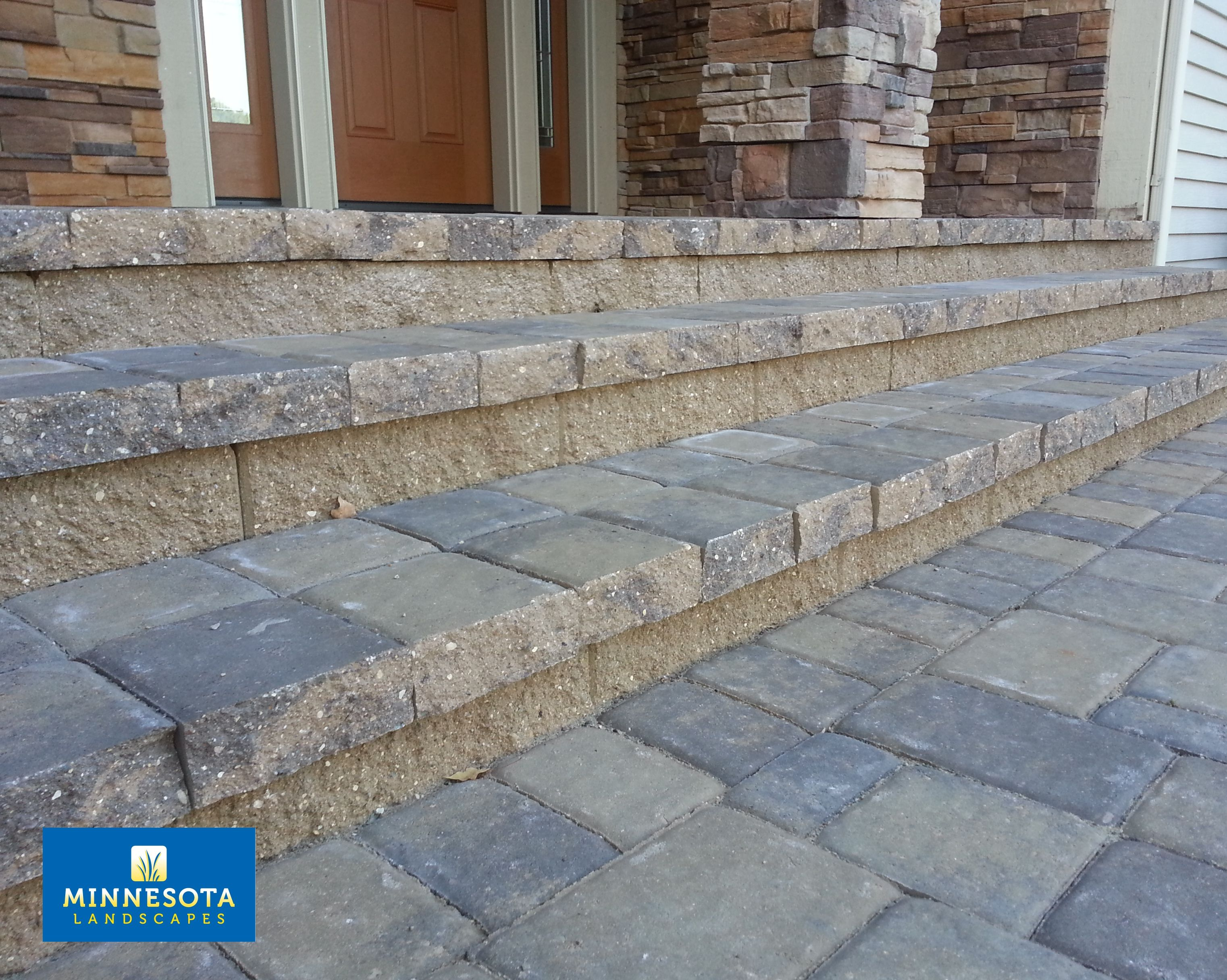 Adhering concrete pavers over the concrete stoop and steps is a
