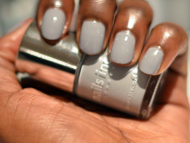Silver nail polish on dark skin