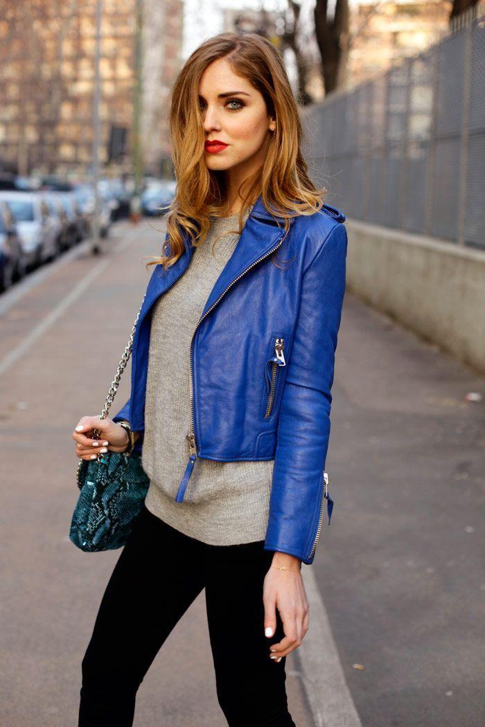 Rock a blue leather biker jacket with black slim jeans to create a chic, glamorous look.   Shop this look on Lookastic: https://lookastic.com/women/looks/blue-biker-jacket-grey-crew-neck-sweater-black-skinny-jeans-teal-crossbody-bag/4221   — Grey Crew-neck Sweater  — Blue Leather Biker Jacket  — Teal Snake Leather Crossbody Bag  — Black Skinny Jeans
