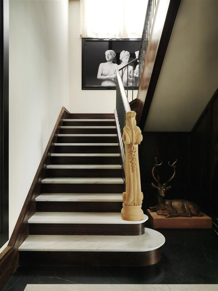 White Marble Staircase With Black Treads Creates An Interesting Visual  Contrast.