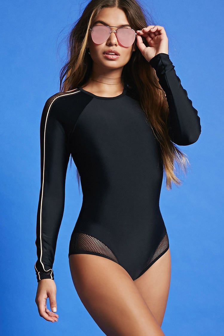 7235419b8c A stretch-knit one-piece swimsuit featuring a high neck, long raglan sleeves  with contrast piping detail, mesh-inserts, and a back cutout.