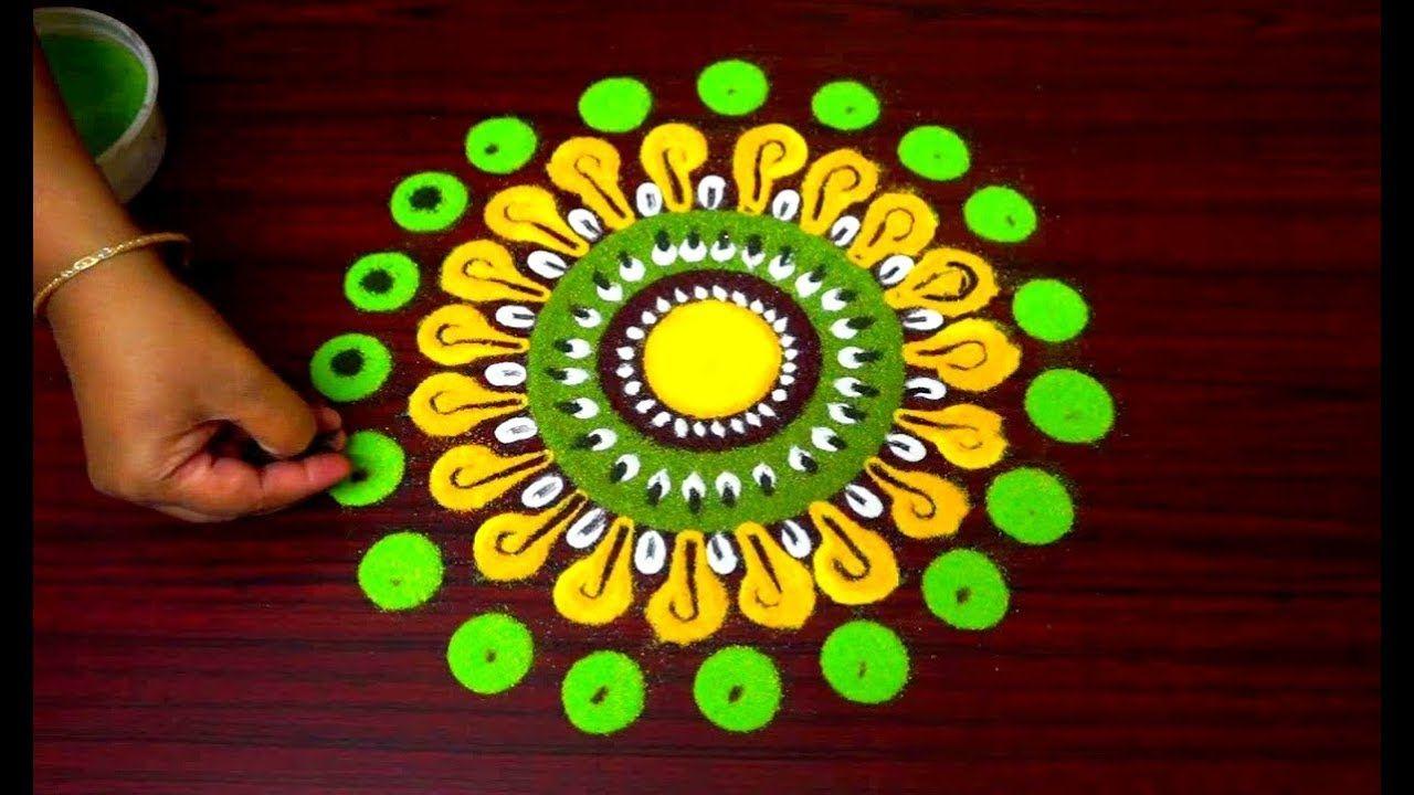 Beautiful innovative multicolored marigold rangoli design