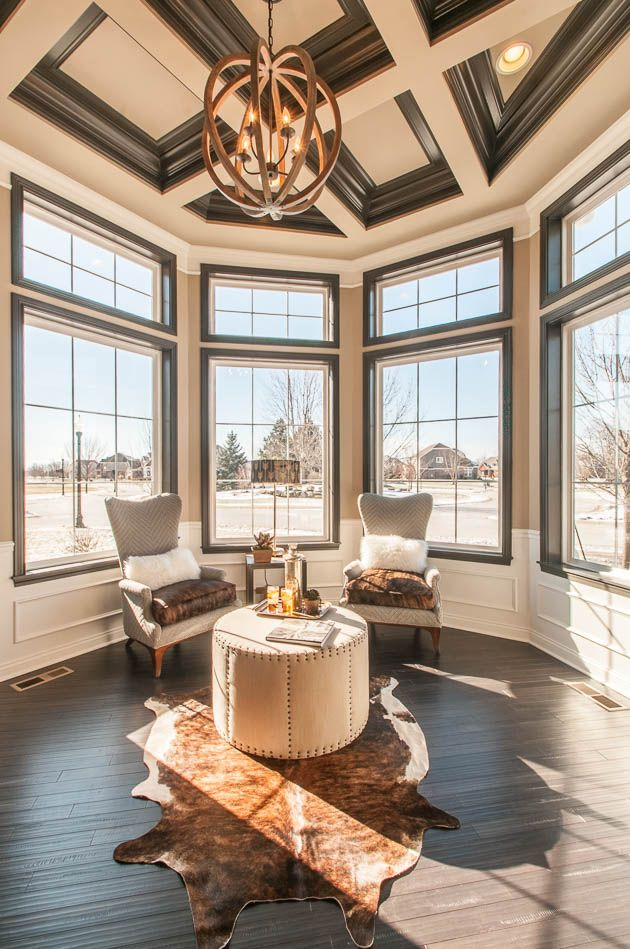 Solarium with large windows and coffered ceiling ...