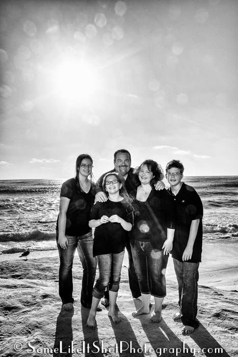 Black and white family photo at wind n sea beach la jolla ca by www somelikeitshotphotography com