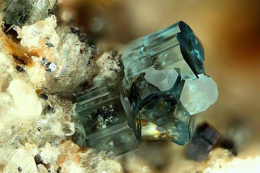 Osumilite-(Mg). Caspar quarry, Bellerberg volcano, Ettringen, Mayen, Eifel, Rhineland-Palatinate, Germany Photo © Stephan Wolfsried