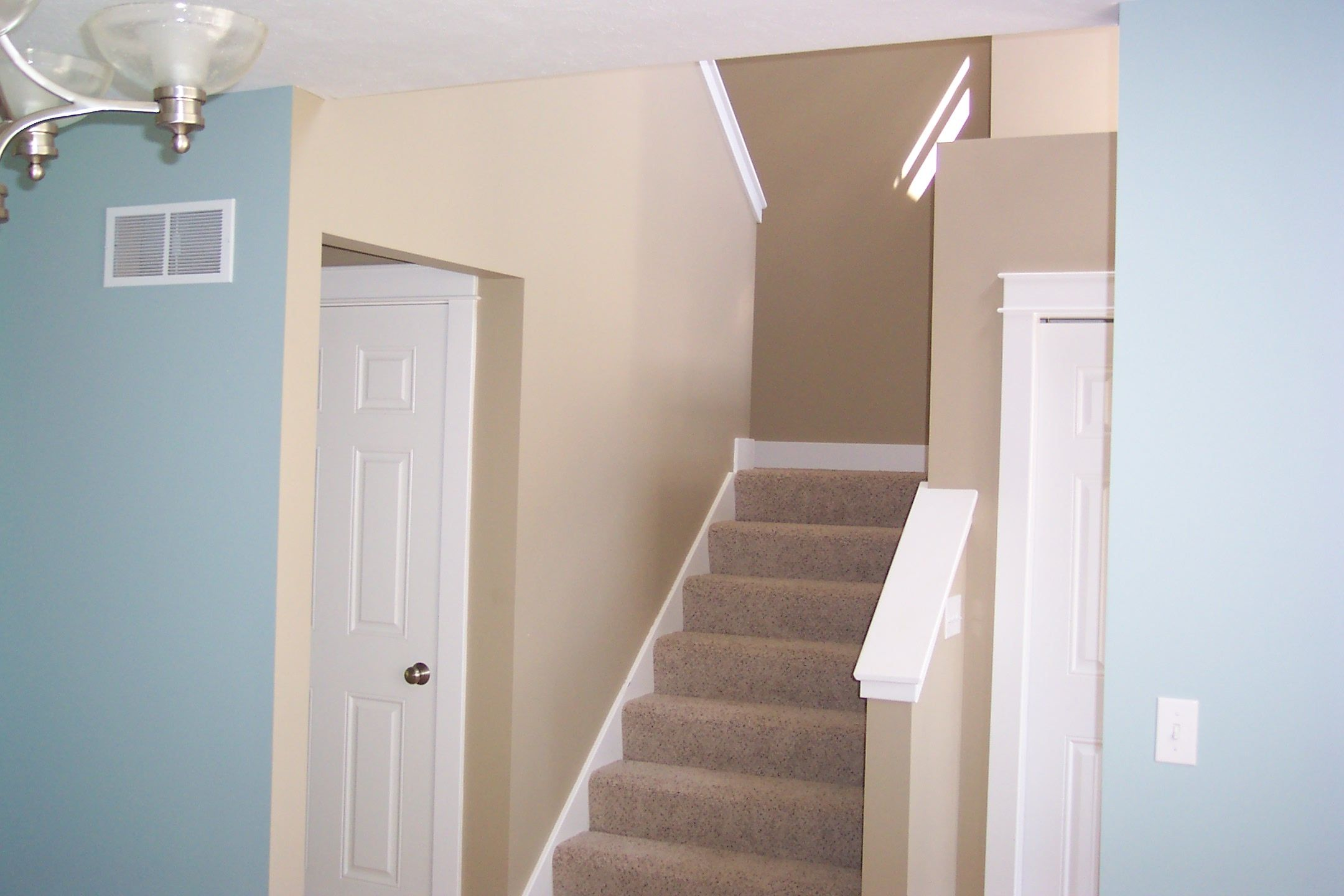 Coat Closet Under U Shaped Stairs - Story Country Porch