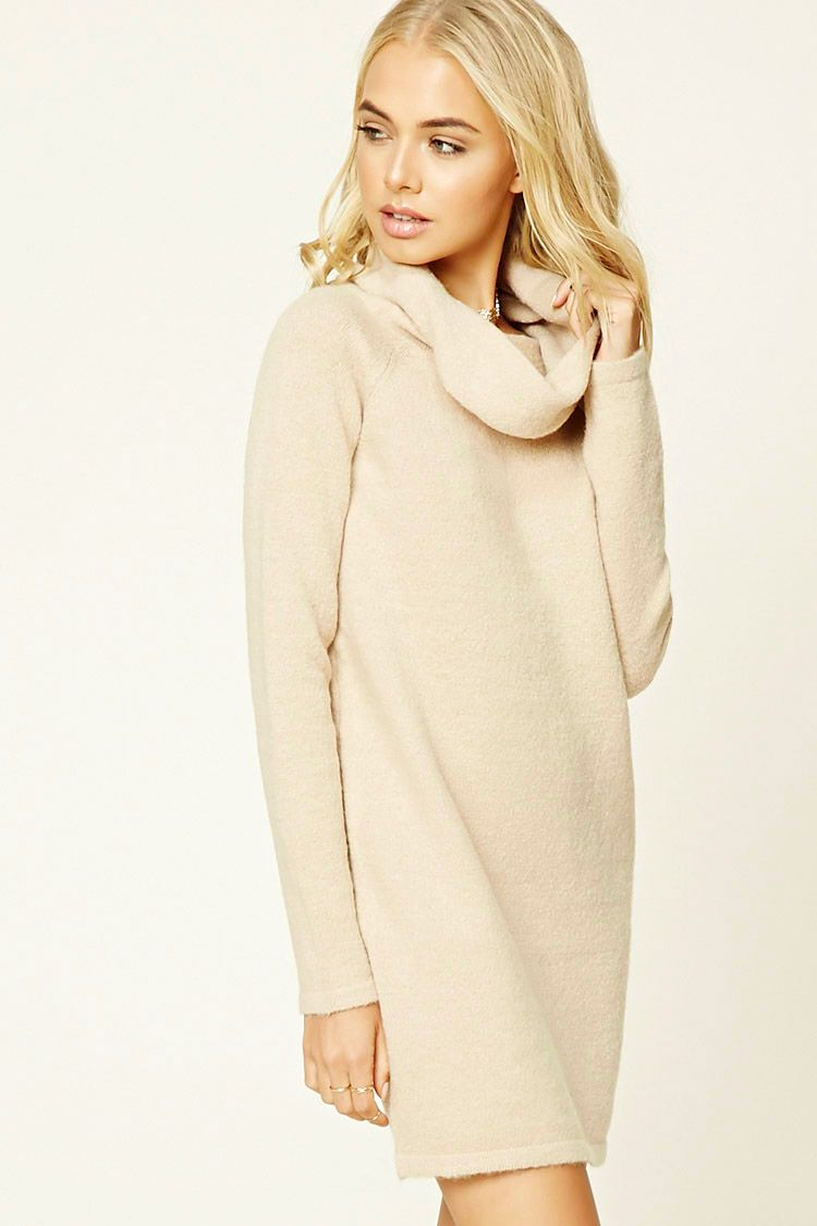 A textured knit sweater dress featuring a cowl neck and long ...