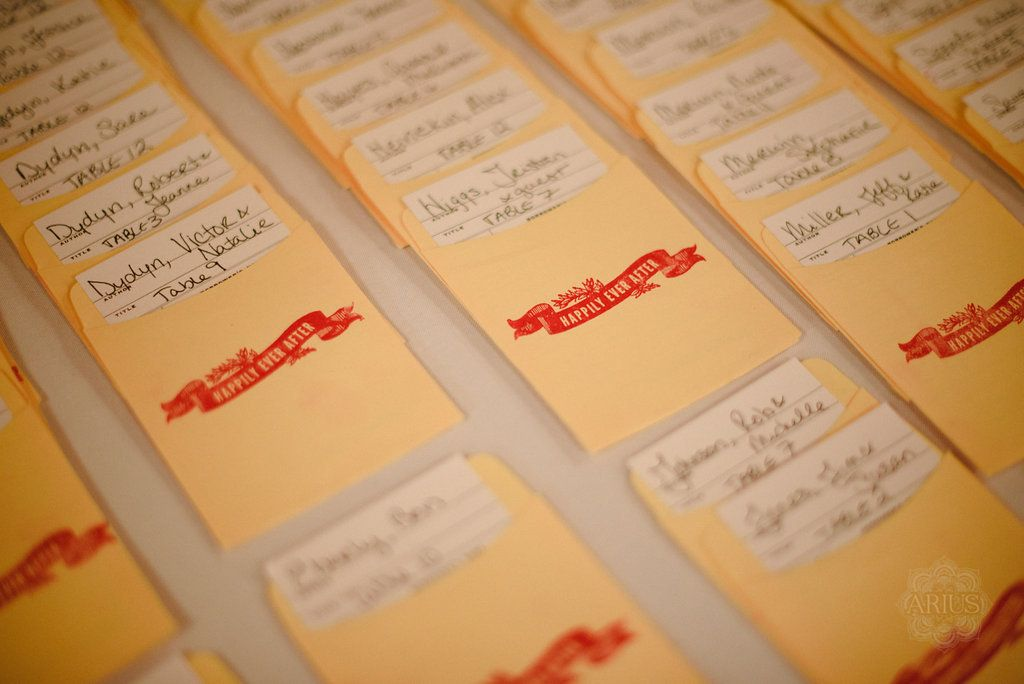 Book Wedding: Library Seating Cards. Photo by Arius Photography, ariusphoto.com