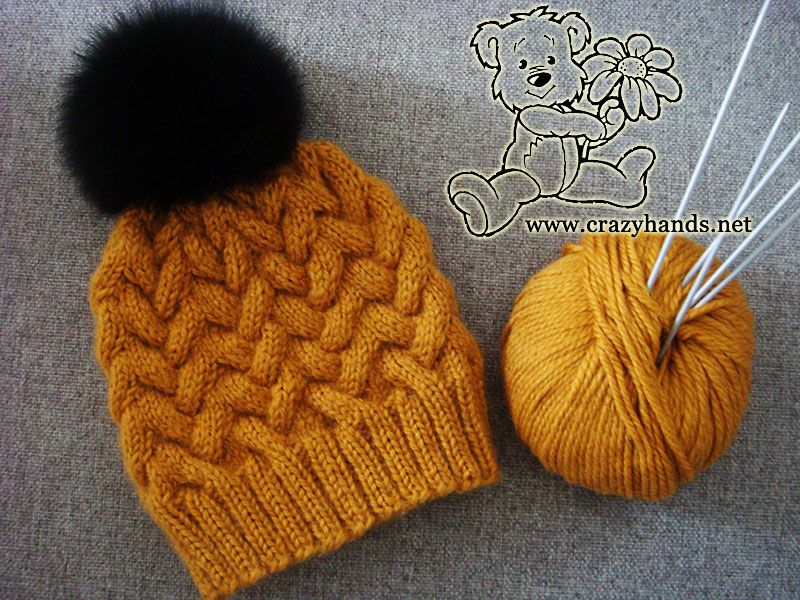 38c99dc8767 This knitted hat pattern with cables is definitely worth spending your time  to get a whimsical looking hat for winter time. Attach a fur pom pom to add  an ...