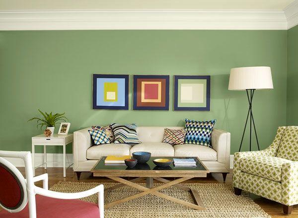fantastische grüne Nuance und drei coole Bilder an der Wand Holz - wohnzimmer grun orange