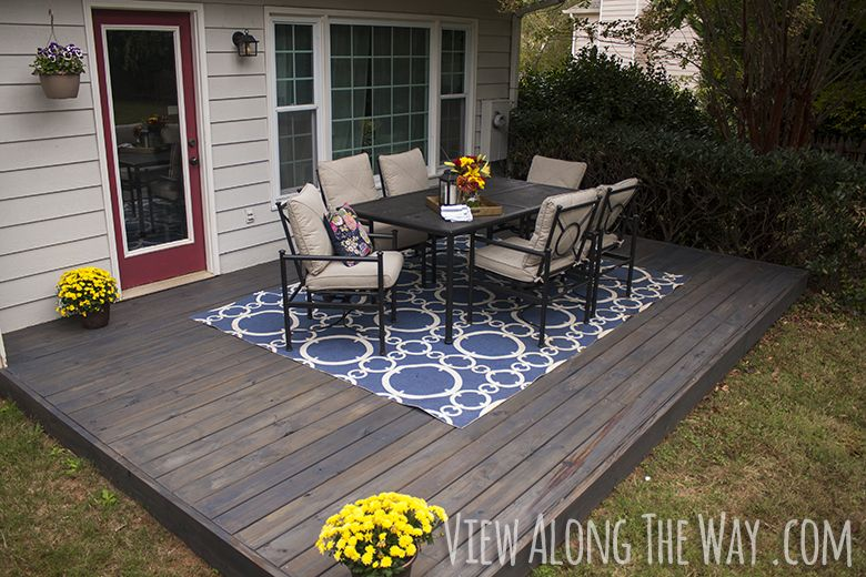 DIY deck over a concrete patio, and tips for staining your