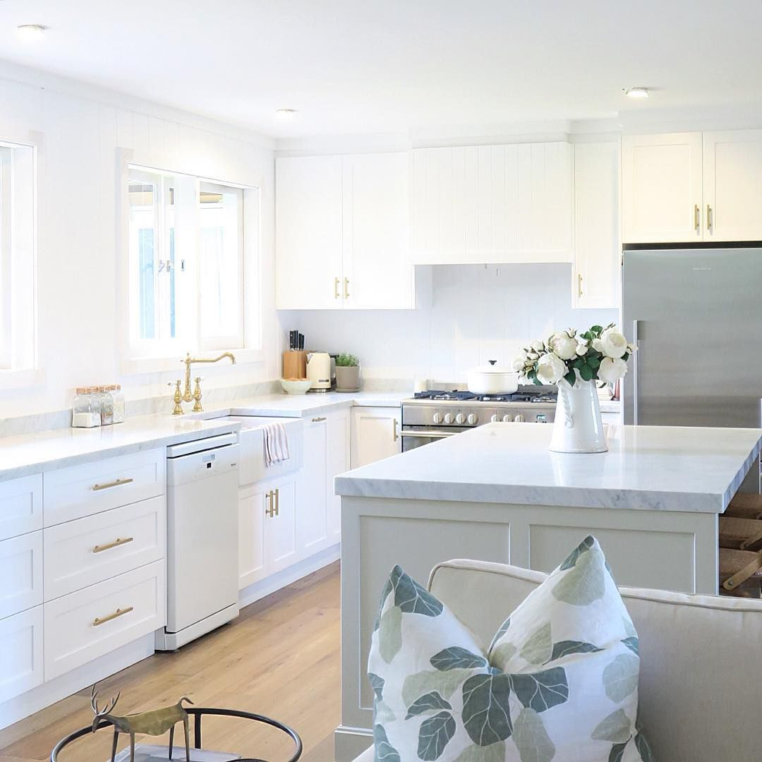White Kitchen With Brass Accents And Pale Grey Green