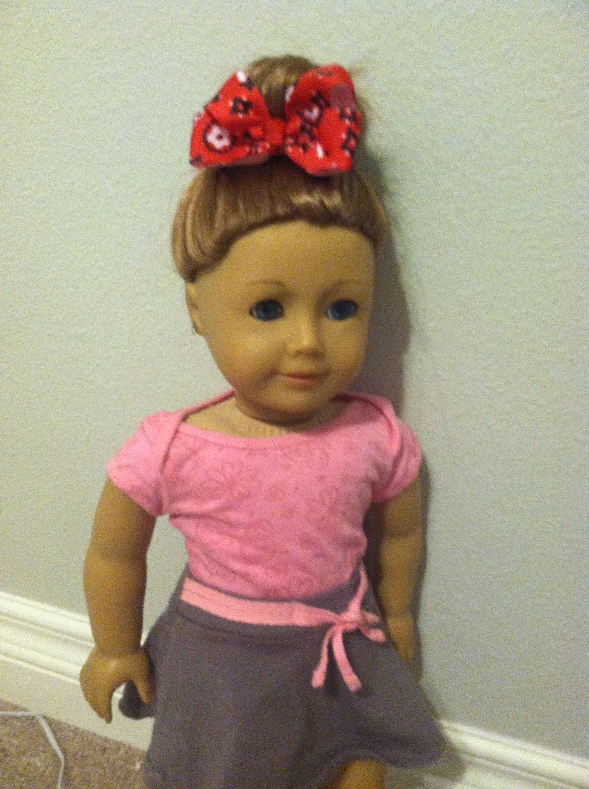 Cute bun and bow hairstyle with claire american girl hair