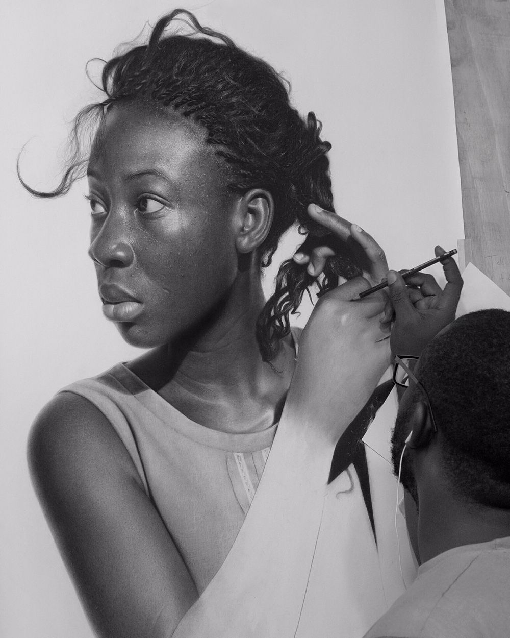 This morning we are admiring the very impressive work of nigerian artist arinze stanley whose hyperreal pencil drawings are almost indistinguishable