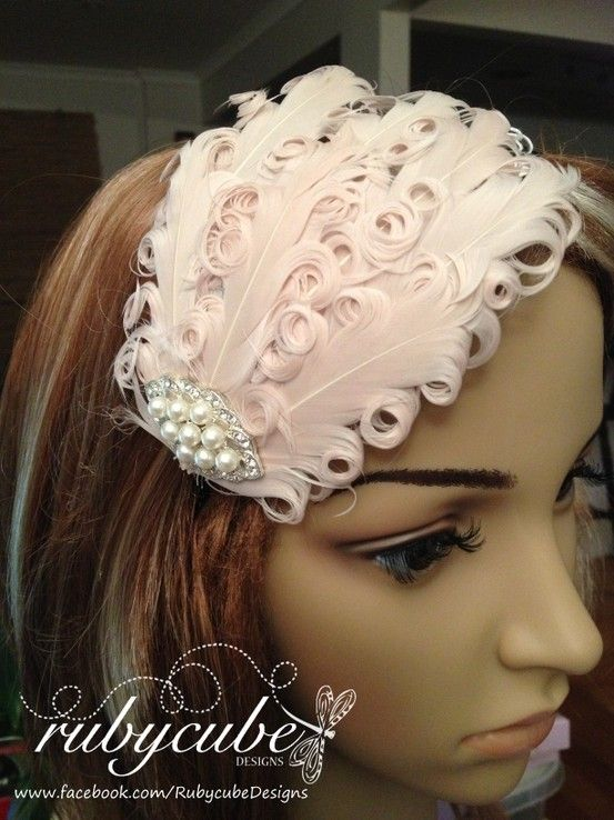 Ivory curled feather fascinator headband embellished with pearl   diamante  jewel. Perfect for every day wear and formal occasions such as weddings 8026dc159e2