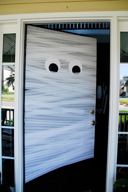 DIY mummy door for just a buck. White streamers wrapped around door. Cut two white circle and 2 smaller black ones. Could be cute for a classroom door! & DIY mummy door for just a buck. White streamers wrapped around door ...