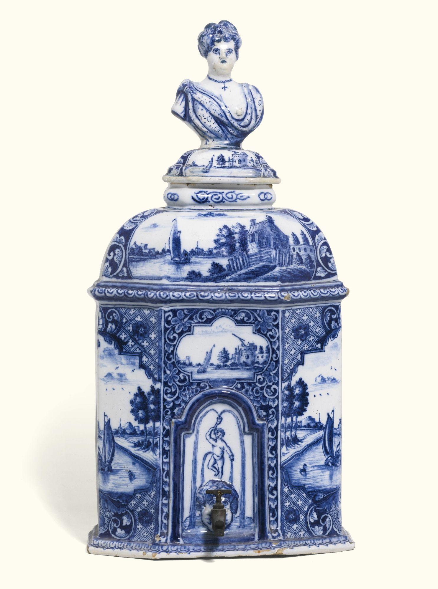 A rare Dutch Delft blue and white ater cistern and cover, circa 1750-1760