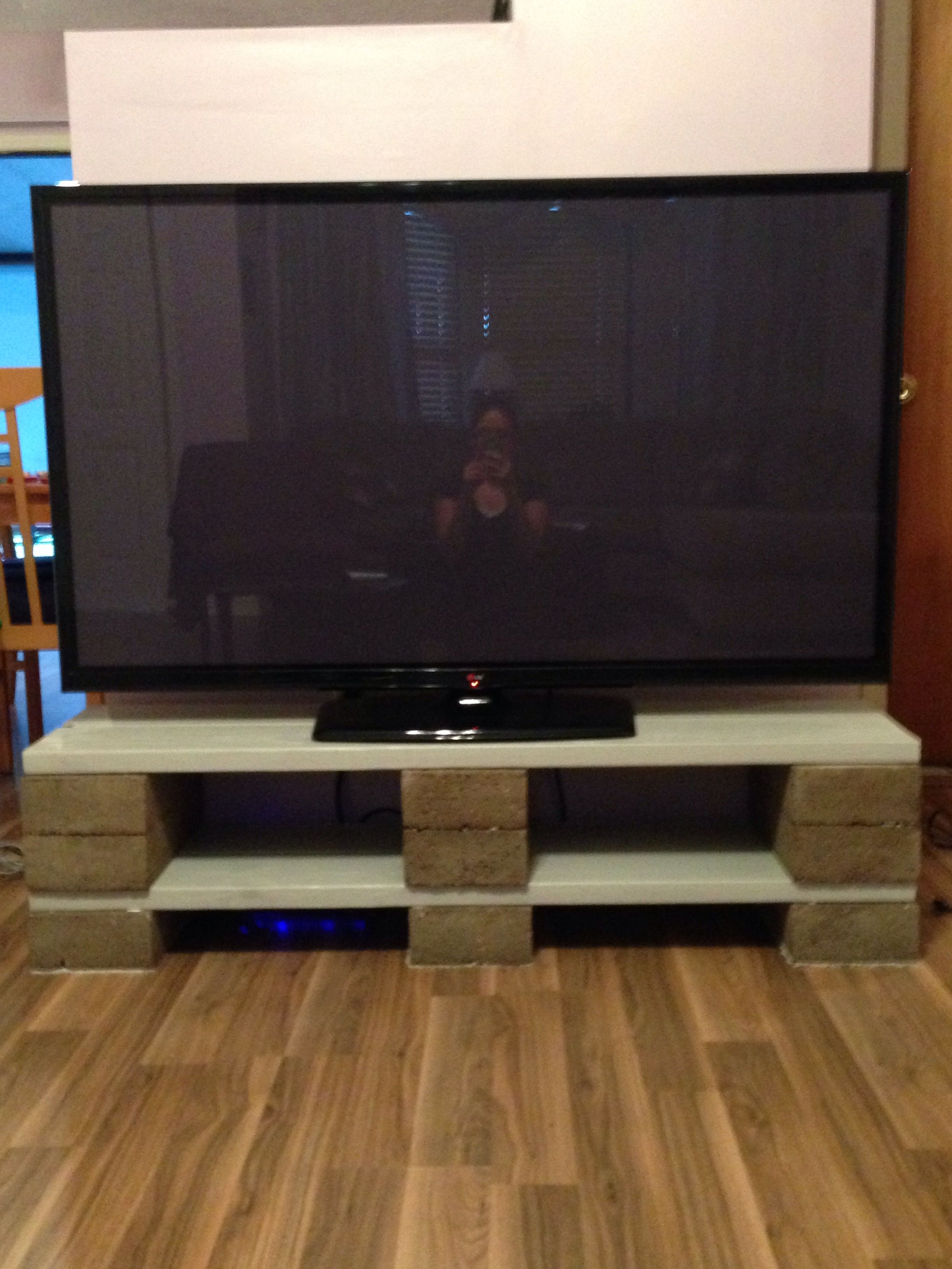Diy tv stand made out of cinder blocks and wood supplies for Block tv stand