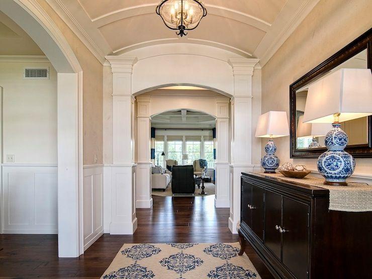 Elegant entryway with barrel ceiling and column detailing. dark ...