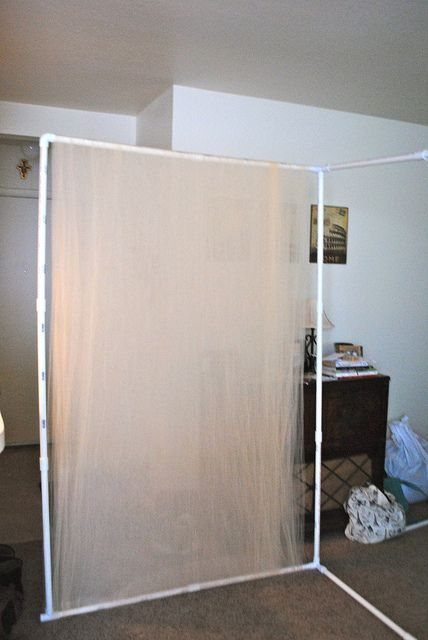 cheap booth back wall tulle and pvc pipes i could hang