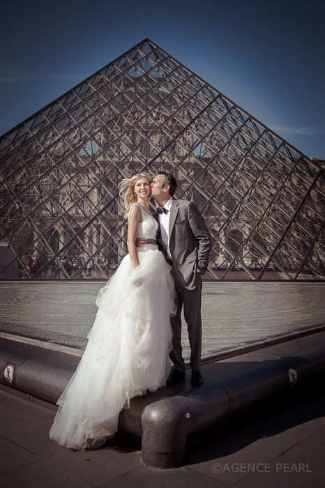 Louvre Pyramid with Celebrant in Paris